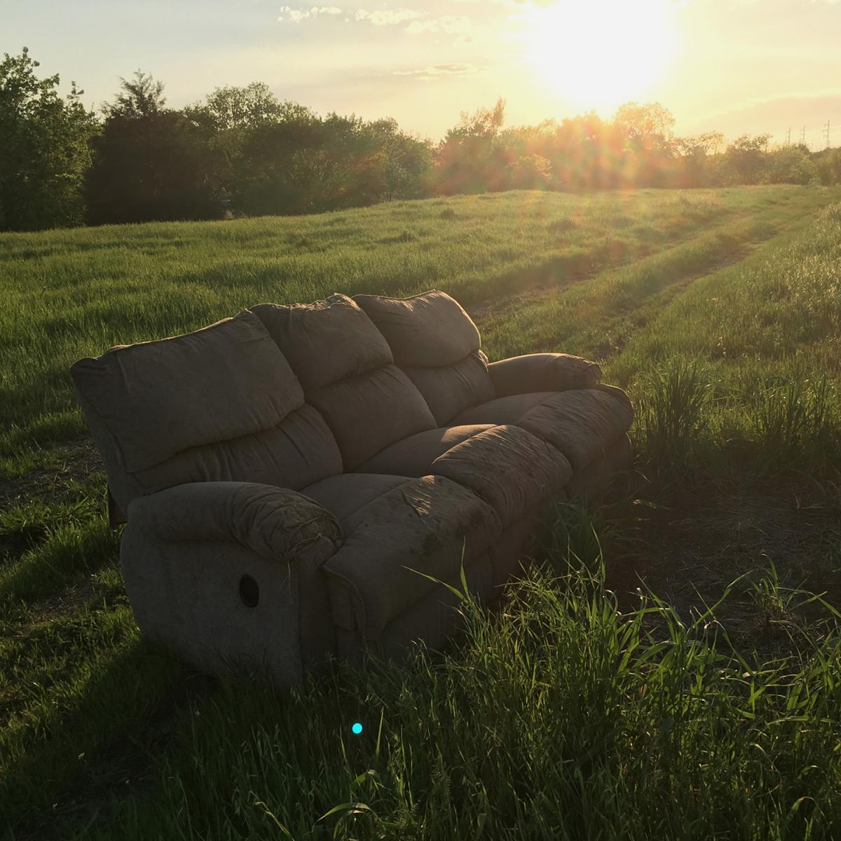 A sofa in a meadow