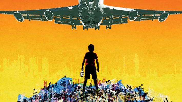 Boy under an airplane