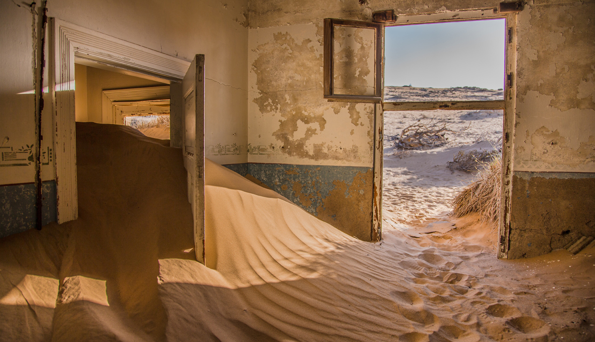 Abandoned house full of sand