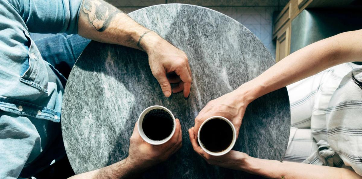 two individuals with coffee