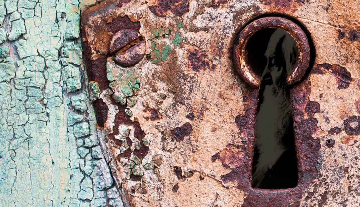 a rusty keyhole with whitman inside