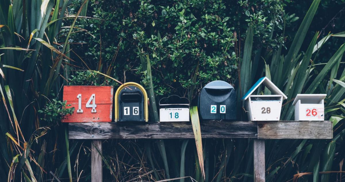Image of mailboxes against greenery