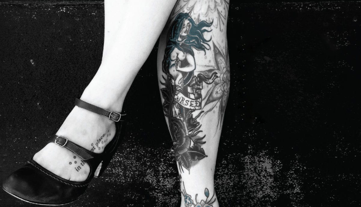 Image of tattooed legs from book cover