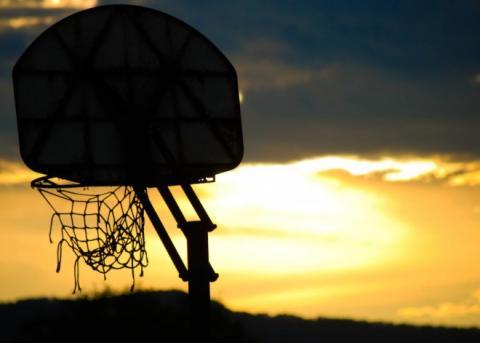 Basketball Hoop Profile Against a Setting Sun