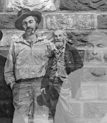 various whitman images faded on top of one another