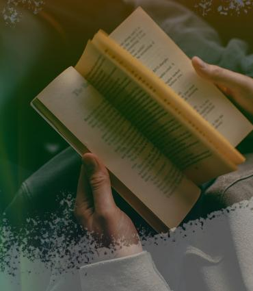 an individual reading a book