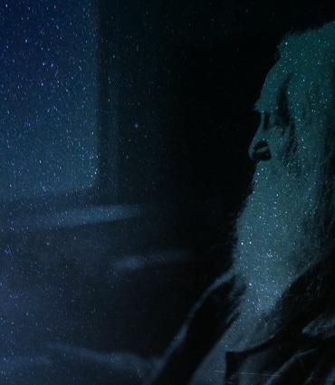 Whitman against the night sky.
