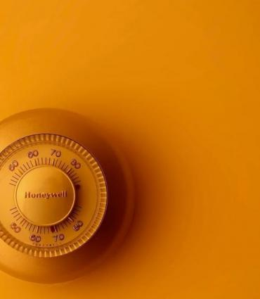 photo of a thermostat in yellow light