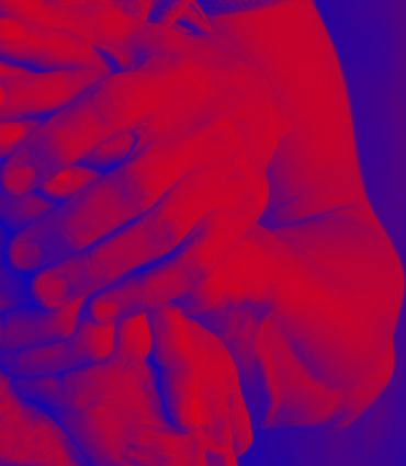 Red and blue hands holding one another