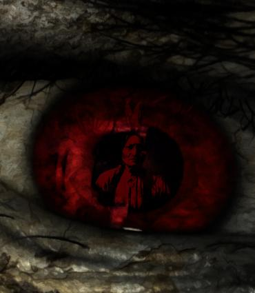 Dark eye with red iris with image of a Native American inside