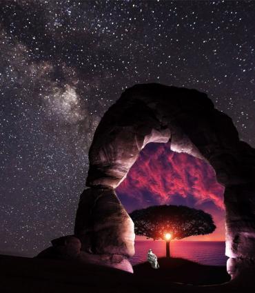 a colorful scene through a stone arch