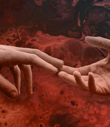 hands touching over red background