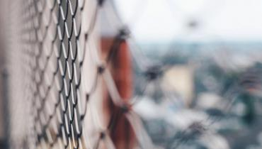 selective focus photo of a fence courtesy of Unsplash